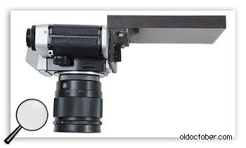 Приспособление для крепления камеры к фотоувеличителю.
