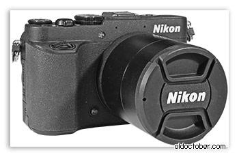 Повышающие кольца и крышка объектива на Nikon Coolpix P7700.