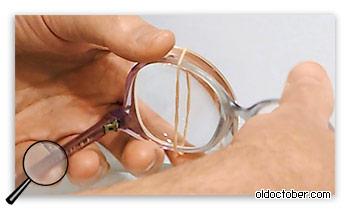 Крепления лупы к очкам с помощью кольцевой резинки.